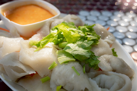 steamed fish dumplings on plate and soy bean paste sauce