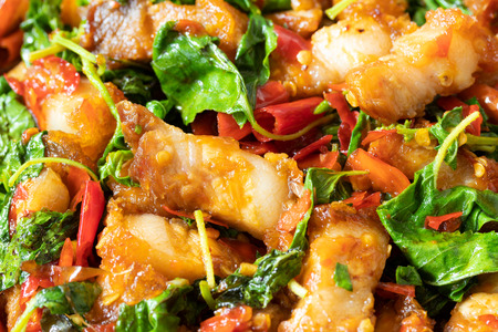 close up of stir fried crispy pork with holy basil leaves , thai food Imagens