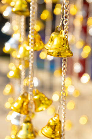 The small golden bells hanging with bokeh background