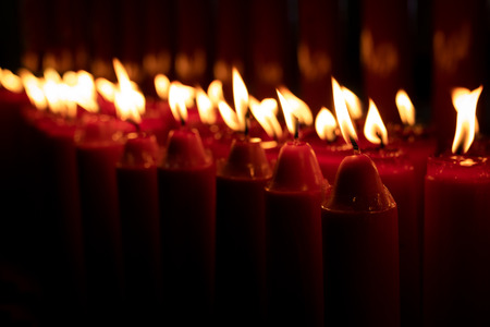 Row of red candles burning