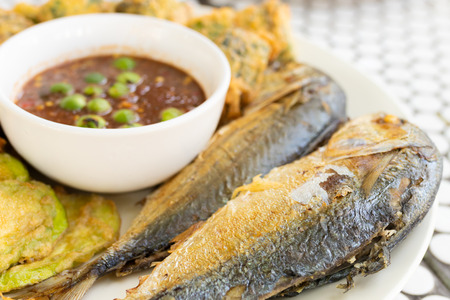 Fried mackerel and shrimp paste sauce on plate (Thai food)