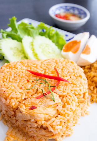 Fried rice with chicken panang curry on dish (thai food)