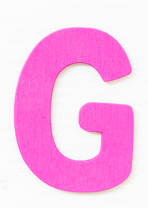 purple wooden alphabet capital letter G isolated on a white background
