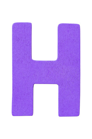 purple wooden alphabet capital letter H isolated on awhite background Imagens
