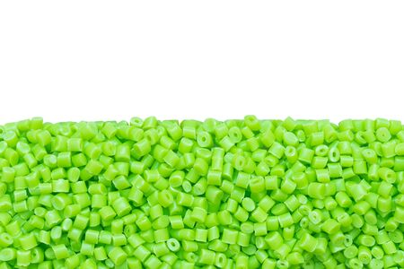 Chartreuse green plastic resin ( Masterbatch ) isolated on white background