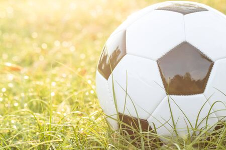 football on grass with bokeh and golden sunlight background Stockfoto - 128853233