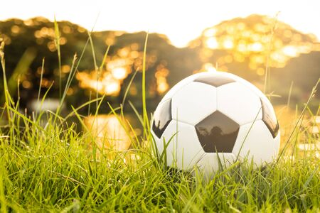 football on grass with sunlight bokeh nature background Stockfoto - 128853239