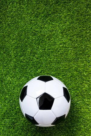 top view of football on green artificial grass field background Stockfoto - 128853242