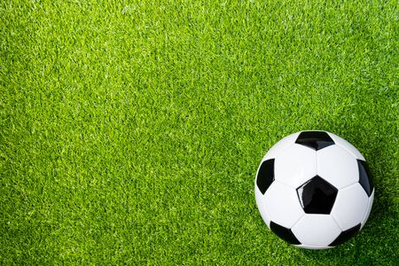 top view of football on artificial grass field background with copy space Stockfoto - 128853245