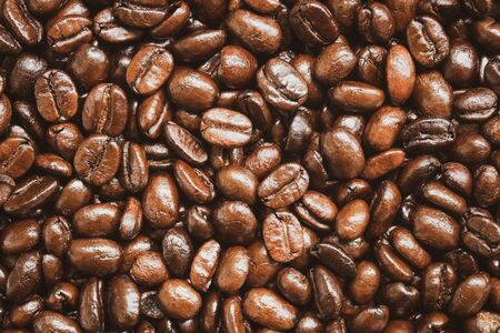 Close up of roasted coffee beans texture and background