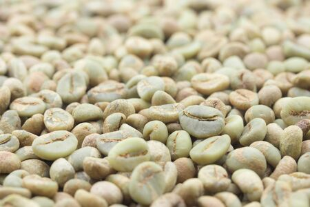 close-up of raw green coffee beans for background