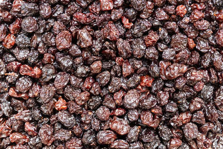 Top view of black raisins for a background