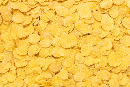 yellow corn flakes for texture and background, breakfast cereal