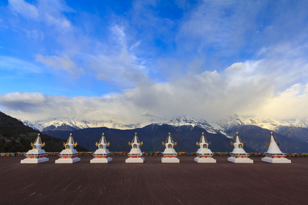 Scenery of  Meili snow mountain and row of Tibetan stupas, this is viewpoint from Feilai temple at Deqing, Yunnan, China. Editorial