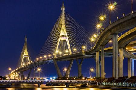 Night cityscape of Bhumibol Bridge (named from King Bhumibol of Thailand) across Chao Phraya River, Bangkok city skyline, Thailand Stock Photo