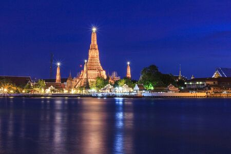 Wat Arun Temple in twilight time, located near Chao Phraya River, famous tourist attraction of Bangkok, Thailand