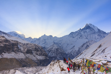 Prayer flags and snow mountain of Himalaya Annapurna base camp with Machapuchare peak in background, Nepal Stock Photo
