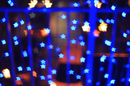 lighting background: Blue star shape light bokeh background, from nightlife city and festive Christmas night decoration.