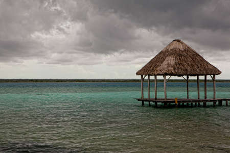 Beatiful bungalo on summer Mexican bay in Chetumal city photo