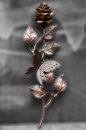 rose butterfly: Beautiful hand made rose with butterfly, made from steel and painted Stock Photo
