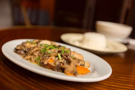 beansprouts: Fried black mushrooms with tofu and rice on the table