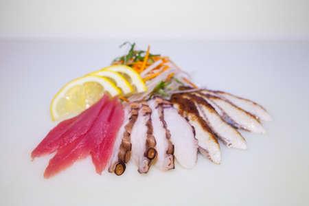 sashimi sushi octapus slices on white background