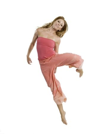 An attractive young woman dancing with joy.