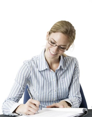 Portrait of a young attractive professional Caucasian female writting. Reklamní fotografie