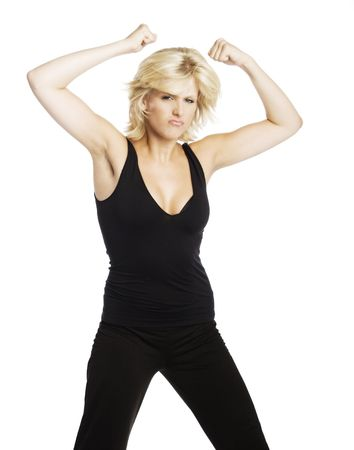 young attractive blond Caucasian woman in black working out on white background.
