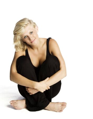 young attractive blond Caucasian woman in black on white background. Imagens