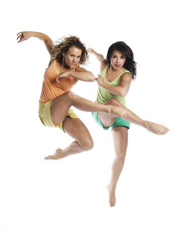 blonde minority: Two dancers dancing in the air on white background. Stock Photo