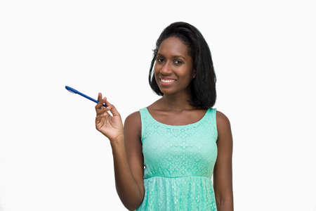 Woman holding pen to left Stock Photo