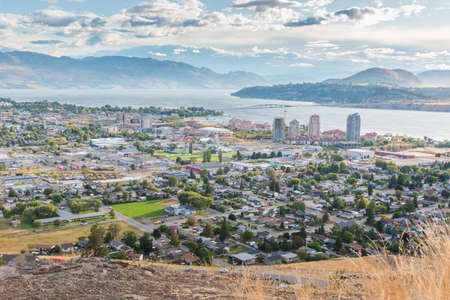 Downtown Kelowna in autumn viewed from Knox Mountain with Okanagan Lake and William R. Bennett bridge in distance 写真素材