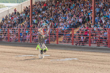 Williams Lake, British Columbia/Canada - July 2, 2016: three time world champion Alex Wells performs a traditional hoop dance at the 90th Williams Lake Stampede.