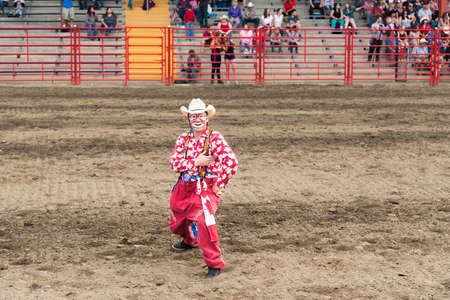 Williams Lake, British Columbia/Canada - July 1, 2016: a rodeo clown entertains the crowds during the 90th Williams Lake Stampede, one the the largest stampedes in North America 報道画像