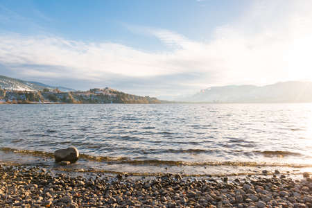 View of Okanagan Lake in winter from Three Mile Beach with Penticton and mountains in distance