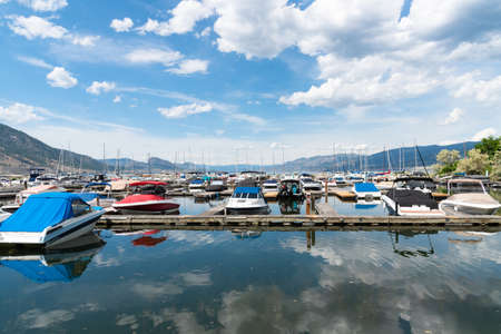 Penticton, British ColumbiaCanada - June 13, 2019: boats moored at the Penticton Yacht Club and Marina, the largest marina on the south end of Okanagan Lake. Editorial