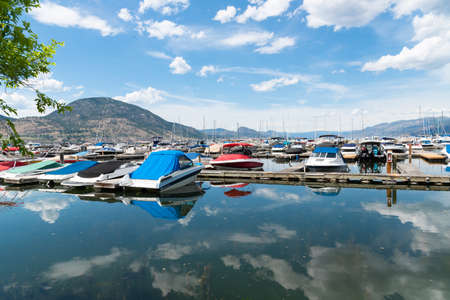 Penticton, British ColumbiaCanada - June 13, 2019: view of boats and docks in summer at the Penticton Yacht Club and Marina, the largest marina on the south end of Okanagan Lake. Editorial