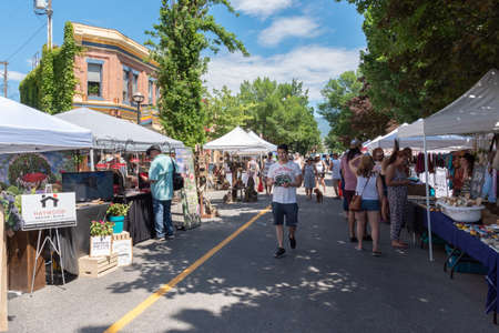 Penticton, British ColumbiaCanada - June 15, 2019: tourists and locals shop at the Penticton Farmers Market, one of the largest outdoor markets in the South Okanagan.