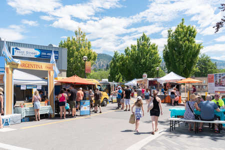 Penticton, British ColumbiaCanada - June 15, 2019:  food trucks and shoppers fill the street at the Penticton Community Market, the largest outdoor market in the South Okanagan.