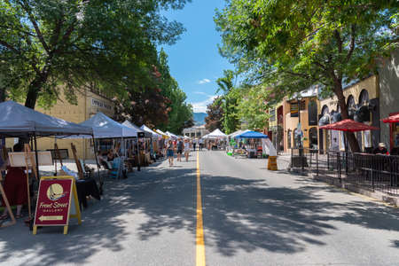 Penticton, British ColumbiaCanada - June 15, 2019: vendors line Front Street for the Penticton Community Market, a popular weekly event for tourists and locals.