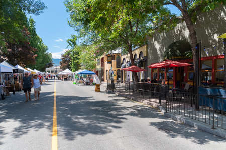 Penticton, British ColumbiaCanada - June 15, 2019: Front Street is lined with vendors during the Penticton Community Market, the largest outdoor market in the South Okanagan.