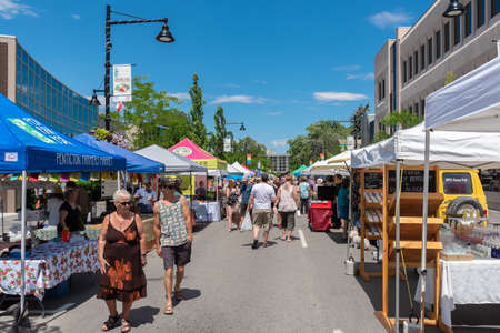 Penticton, British ColumbiaCanada - June 15, 2019: people shopping at the Penticton Farmers Market on Main Street, one of the largest farm markets in the South Okanagan.