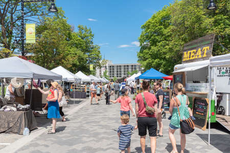 Penticton, British ColumbiaCanada - June 15, 2019: people walking through the Penticton Farmers Market, a popular weekly market for tourists and locals.