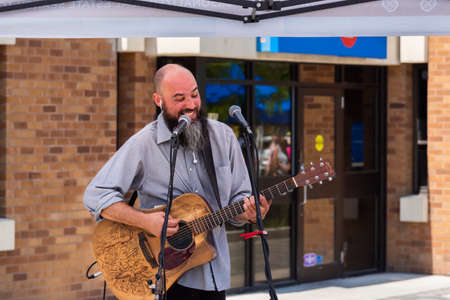 Penticton, British ColumbiaCanada - June 15, 2019: a musician performs at the Penticton Community Market, the largest outdoor market in the South Okanagan