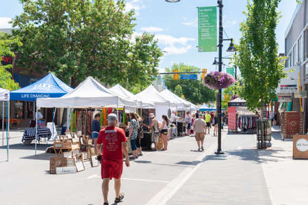 Penticton, British ColumbiaCanada - June 15, 2019: people browse the various tables of goods for sale at the weekly Penticton Community Market on Main Street, a popular summer event.