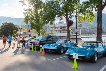 Penticton, British ColumbiaCanada - June 21, 2019: vehicles parked along Okanagan Lake for the Peach City Beach Cruise, one of North Americas top car shows.