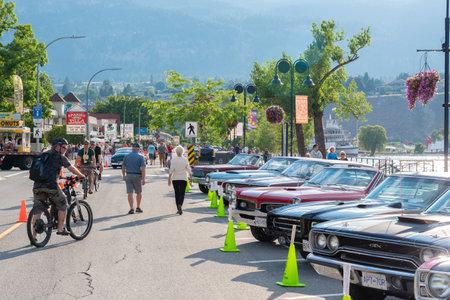 Penticton, British ColumbiaCanada - June 21, 2019: cars parked along Lakeshore Drive for Peach City Beach Cruise, a large annual car show.