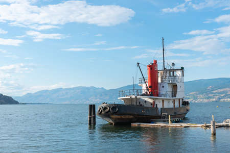 Penticton, British ColumbiaCanada - June 21, 2019: Canadian National Tug No. 6, a historic vessel launched in 1948, is docked at the waterfront on Okanagan Lake.