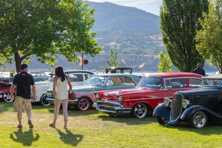 Penticton, British ColumbiaCanada - June 22, 2019: people viewing vintage cars on display at the Peach City Beach Cruise, a popular annual car show.
